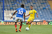 AFC Wimbledon Defender, Tennai Watson (2) gets the ball before Portsmouth Midfielder, Jamal Lowe (10) during the Carabao Cup match between Portsmouth and AFC Wimbledon at Fratton Park, Portsmouth, England on 14 August 2018.