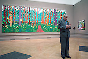 "David Hockney stands in front of his painting called "" The arrival of Spring in Woldgate in East Yorkshire 2011 at The RAA on January 16th 2011...Photo Ki Price."