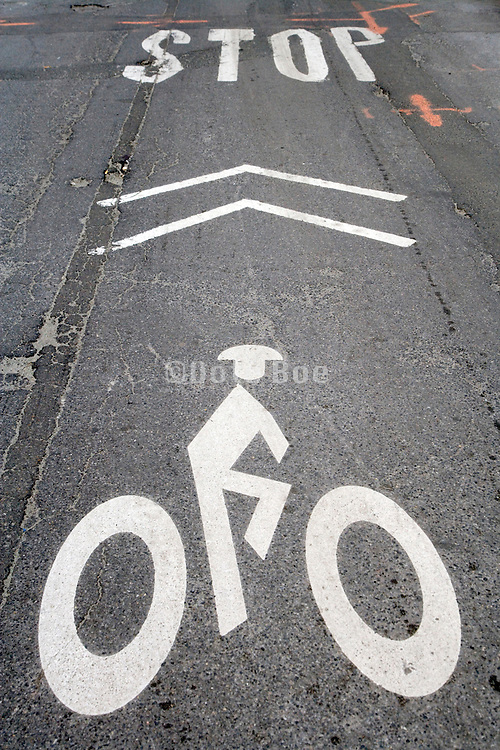 bicycle and stop signal on an damaged asphalt road with road repair instructions orange marks