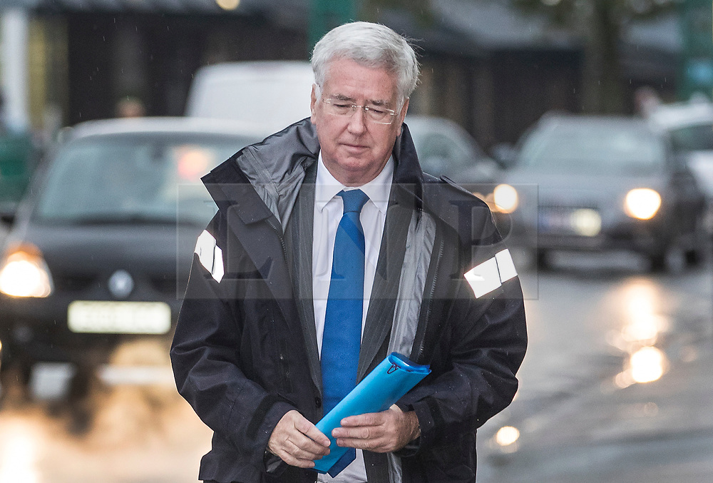 """© Licensed to London News Pictures. 04/11/2017. Swanley, UK. Former Defence Secretary Sir Michael Fallon arrives for a constituency meeting Swanley. Sir Michael resigned his cabinet position after admitting that his behaviour towards women in the past has """"fallen short"""". Photo credit: Peter Macdiarmid/LNP"""