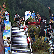 Reon Boe from Queenstwown heads down the Brecon Street steps in Queenstown to win the Corona Dirtmasters Downhill event in Queenstown, Central Otago. Eighty competitors tackled the technically demanding course which started at the Gondola summit and finished with a run down the steps in Brecon Street, Queenstown. The event was part of the inaugural Queenstown Bike Festival, which took place from 16th-25th April. The event hopes to highlight Queenstown's growing profile as one of the three leading biking centres in the world. Queenstown, Central Otago, New Zealand. 24th April 2011. Photo Tim Clayton...