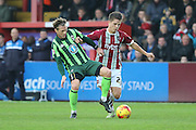 Dannie Bulman of AFC Wimbledon and Tom Nichols Exeter City tussle during the Sky Bet League 2 match between Exeter City and AFC Wimbledon at St James' Park, Exeter, England on 28 December 2015. Photo by Stuart Butcher.