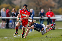 Bristol Rugby Fly-Half Matthew Morgan is tackled by London Scottish Flanker Evan Olmstead - Mandatory byline: Rogan Thomson/JMP - 02/04/2016 - RUGBY UNION - Richmond Athletic Ground - London, England - London Scottish v Bristol Rugby - Greene King IPA Championship.