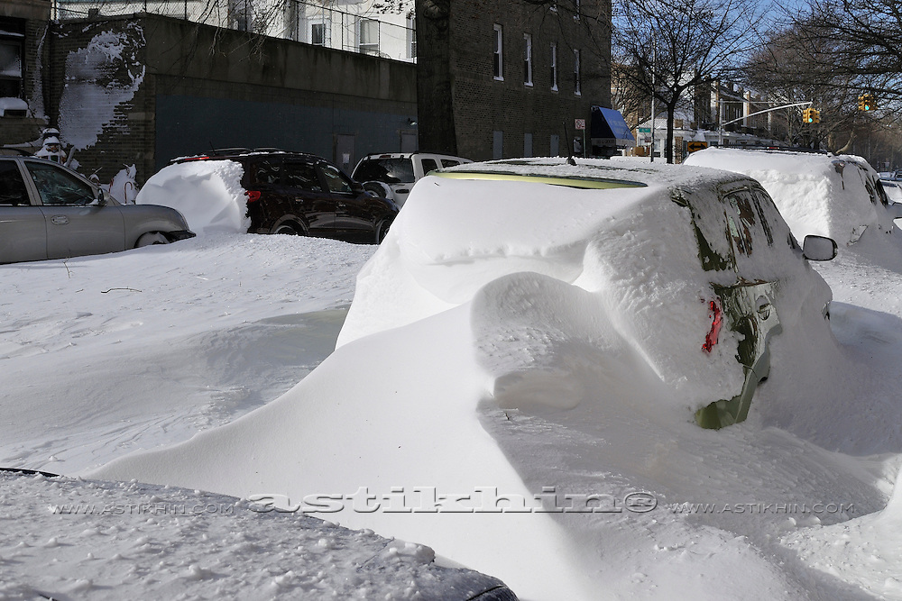 Car and snowdrift in Brooklyn NYC