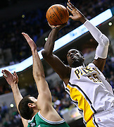 March 28, 2011; Indianapolis, IN, USA; Indiana Pacers center Roy Hibbert (55) shoots against Boston Celtics center Nenad Kristic (4) at Conseco Fieldhouse. Mandatory credit: Michael Hickey-US PRESSWIRE