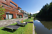 Neufelden, Austria. Genießerhotel Mühltalhof. Residents can take a swim in the artificial lake of Mühl river in front of the hotel.