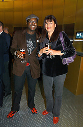 MR & MRS ORLANDO HAMILTON at a party to celebrate the launch of Pilsner Urquell beer held in the Pavillion at The Serpentine Gallery, London on 4th October 2006.<br />