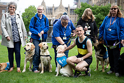 © Licensed to London News Pictures. 25/04/2019. London, UK. Secretary of State for Wales Alun Cairns poses for a photocall with guide dogs in College Green, Westminster. Alun Cairns is running the 2019 London Marathon this Sunday for the Guide Dogs charity. Photo credit : Tom Nicholson/LNP
