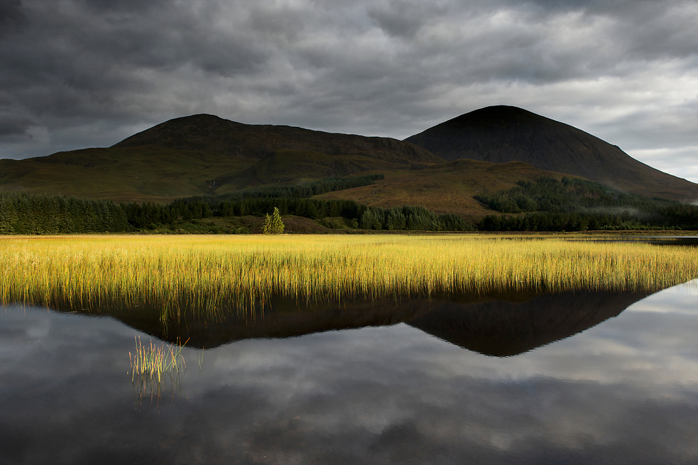 """Loch Cill Chriosd in Strath Suardal on the Isle of Skye is perfectly calm in the predawn light.  Behind the Loch on the right is Benn na Caillich, one of the Red Cuillins.  Locals know the loch as the """"hairy"""" loch.  To buy this print click on the SHOPPING CART below."""