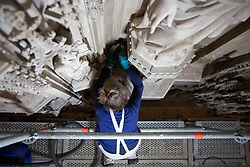 © Licensed to London News Pictures. 07/02/2018. WINCHESTER, UK. A conservator cleans the Great Screen at Winchester Cathedral, Hampshire, to remove dirt and dust from the 540-year-old stonework using soft brushes and hand-held vacuum cleaners as part of a programme of urgent repairs to the Cathedral's presbytery which has been carried out over the last three years. According to Cathedral records, this will be the first time that the Great Screen has been cleaned since the 1890s. Photo credit: ISABEL INFANTES/LNP