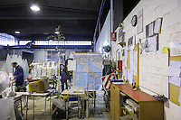 SOVERIA MANNELLI, ITALY - 16 NOVEMBER 2016: A map of Italy is seen here in the warehouse of Camillo Sirianni, a school furniture manifacturer in Soveria Mannelli, Italy, on November 16th 2016.<br /> <br /> Camillo Sirianni is a third generation family business that started as a family mechanized carpentry in 1909 and transformed into a leading school furniture manufacturer. In a high-tech warehouse in the outskirts of Soveria Mannelli, they assemble thousands of Calabrian beechwooden, colorful desks, benches, closets and other accessories that are later shipped to many corners of the globe, from the United Kingdom to the Emirates, from central America to Polynesia.<br /> <br /> Soveria Mannelli is a mountain-top village in the southern region of Calabria that counts 3,070 inhabitants. The town was a strategic outpost until the 1970s, when the main artery road from Naples area to Italy's south-western tip, Reggio Calabria went through the town. But once the government started building a motorway miles away, it was cut out from the fastest communications and from the most ambitious plans to develop Italy's South. Instead of despairing, residents benefited of the geographical disadvantage to keep away the mafia infiltrations, and started creating solid businesses thanks to its administrative stability, its forward-thinking mayors and a vibrant entrepreneurship numbering a national, medium-sized publishing house, a leading school furniture manufacturer and an ancient woolen mill.