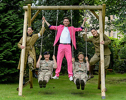 Pictured: Brigadier Suzanne Anderson and Brigadier Robin Lindsay Commander 51 Brigade pushed by performer Nick Alban from show The Happiness Project along with opera singers Lila Palmer and Teiya Kasahara from the show Dead Equal.<br /> <br /> The Army at the Fringe venue opened it's doors today, with five shows on. <br /> <br /> © Dave Johnston / EEm