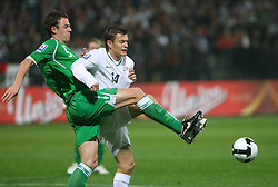 Jonathan Evans and Zlatko Dedic (14) at the fourth round qualification game of 2010 FIFA WORLD CUP SOUTH AFRICA in Group 3 between Slovenia and Northern Ireland at Stadion Ljudski vrt, on October 11, 2008, in Maribor, Slovenia.  (Photo by Vid Ponikvar / Sportal Images)