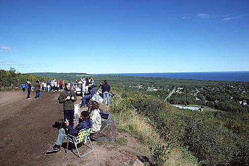 Bird watchers looking for hawks along Hawk Ridge Duluth, Minnesota. Fall.