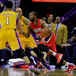 Apr 8, 2016; New Orleans, LA, USA; New Orleans Pelicans guard Jordan Hamilton (25) drives past Los Angeles Lakers guard D'Angelo Russell (1) during the second quarter of a game at the Smoothie King Center. Mandatory Credit: Derick E. Hingle-USA TODAY Sports