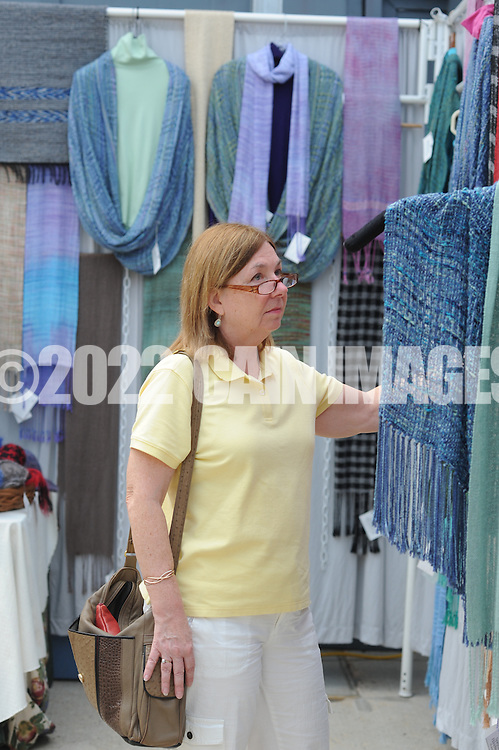 NEW HOPE, PA - SEPTEMBER 06: Susan Flynn of Newtown, Pennsylvania views some of the hand crafted scarves during Bucks County Guild of Craftsmen's third annual Fine Crafts show at the New Hope Winery September 6, 2014 in New Hope, Pennsylvania. (Photo by William Thomas Cain/Cain Images)