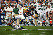 San Diego Chargers wide receiver Vincent Jackson (83) gets upended by airborne New York Jets linebacker David Harris (52) and safety Kerry Rhodes (25) after catching a first quarter pass good for a first down at the New York Jets 41 yard line during an AFC Divisional Playoff game against the New York Jets, January 17, 2010 in San Diego, California. The Jets won the game 17-14. ©Paul Anthony Spinelli