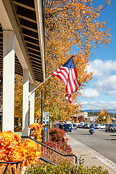 """Downtown Truckee 68"" - Autumn photograph of the American Flag in Historic Downtown Truckee, California."