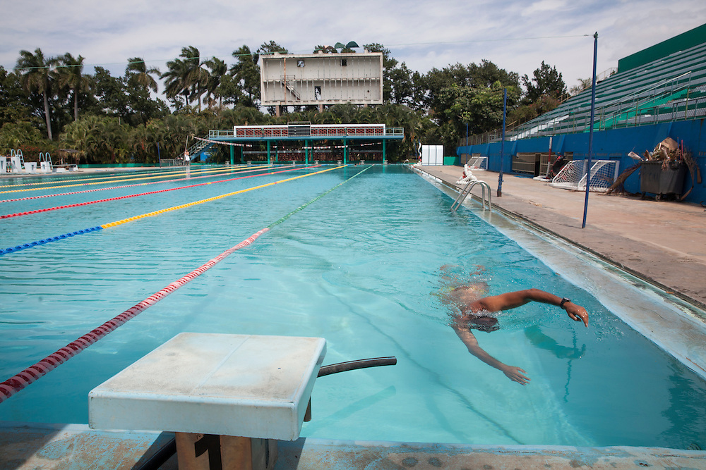 A swimmer trains at the old pool of Havana's Ciudad Deportiva.