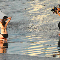 New York photographer Matee Rakvit shoots his model Renee at Santa Monica Beach amid the sunset on Friday, November 5, 2010.