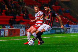 Derrick Williams of Blackburn Rovers holds off possession from Niall Mason of Doncaster Rovers - Mandatory by-line: Ryan Crockett/JMP - 24/04/2018 - FOOTBALL - The Keepmoat Stadium - Doncaster, England - Doncaster Rovers v Blackburn Rovers - Sky Bet League One