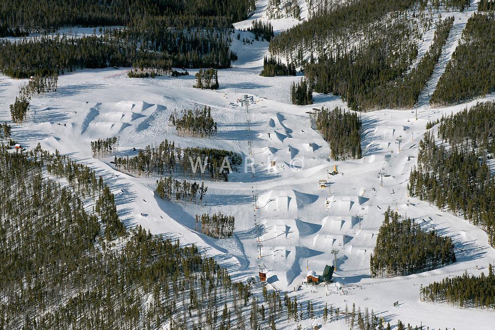 Keystone Ski Area. Snowboarding jumps, Peru Express Lift. March 2014