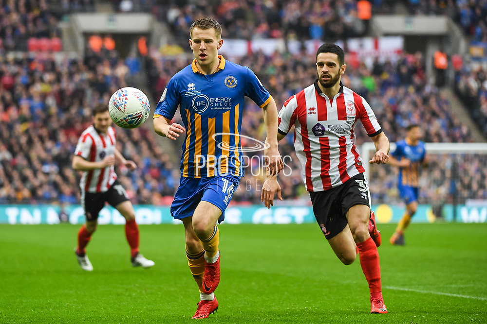 Bryn Morris of Shrewsbury Town (16) and Samuel Habergham of Lincoln City (3) in action during the EFL Trophy Final match between Lincoln City and Shrewsbury Town at Wembley Stadium, London, England on 8 April 2018. Picture by Stephen Wright.