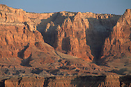 Sunrise light on red sandstone cliffs near Navajo Bridge, Vermilion Cliffs National Monument, near Page, Arizona