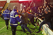 Pitch invasion during the The FA Cup match between Walsall and Darlington at the Banks's Stadium, Walsall, England on 9 November 2019.