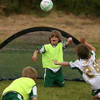 Jordan Freeman tries to stop the throw by Zac Wheelehan at the FAI summer soccer camp in Gallery Park in Kilrush during the week.<br /> Photograph by Yvonne Vaughan