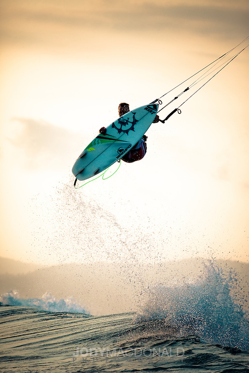 Ben Wilson skies a huge air off Periscopes in Sumbawa, Indonesia at sunset.  A master unstrapped kiteboarder, Ben makes the very difficult look easy.