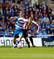 Photo: Leigh Quinnell.<br /> Reading v Sheffield United. Coca Cola Championship.<br /> 01/10/2005. Readings James Harper and Sheffield Uniteds Alan Quinn battle for the ball.