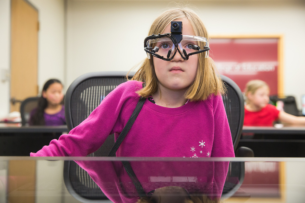 Ava Grow, 8, a third-grade student at Sunnyside Elementary in Pullman, Wash., wears a pair of eye-tracking glasses during a field trip to the Washington State University neurocognition sciene lab Monday, Feb. 22, 2016.