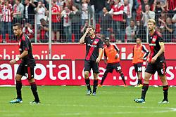 17.09.2011,  BayArena, Leverkusen, GER, 1.FBL, Bayer 04 Leverkusen vs 1. FC Koeln, im Bild.von links:  Renato Augsto (Leverkusen #10), Stefan Reinarzt (Leverkusen #3) und Simon Rolfes (Leverkusen #6) entaeuscht / entäuscht / traurig nach dem 0:3..// during the 1.FBL, Bayer Leverkusen vs 1. FC Köln on 2011/09/17, BayArena, Leverkusen, Germany. EXPA Pictures © 2011, PhotoCredit: EXPA/ nph/  Mueller *** Local Caption ***       ****** out of GER / CRO  / BEL ******