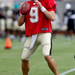 July 28, 2012; Metairie, LA, USA; New Orleans Saints quarterback Drew Brees (9) during a training camp practice at the team's practice facility. Mandatory Credit: Derick E. Hingle-US PRESSWIRE