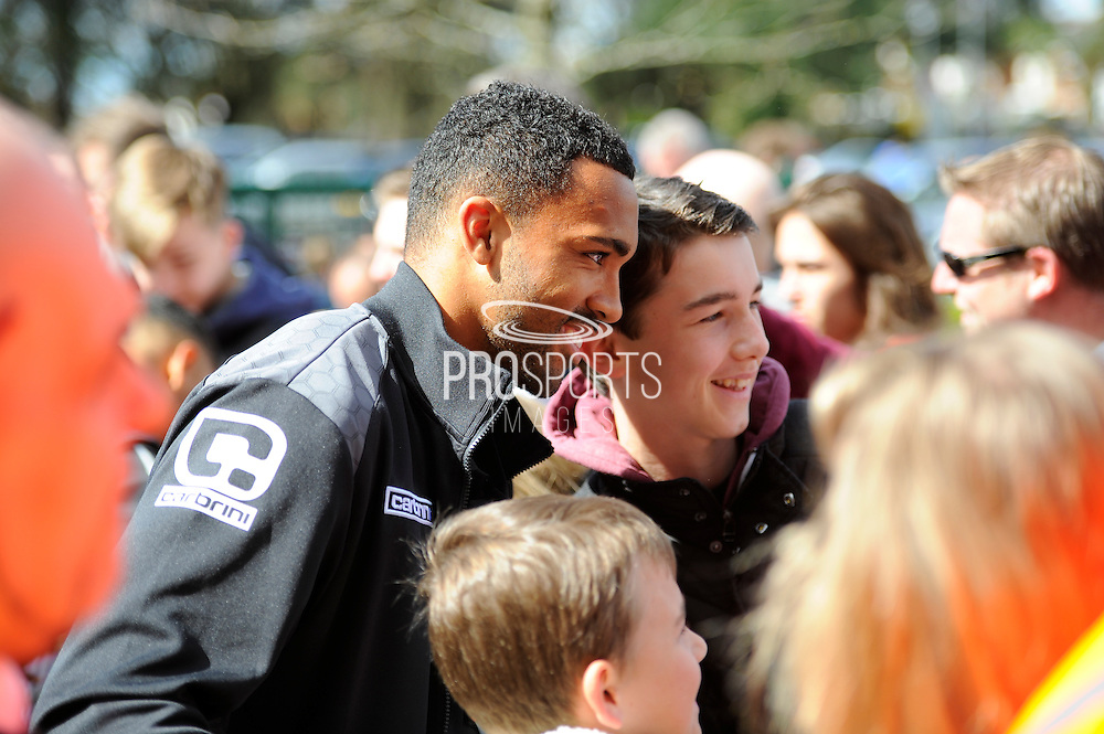AFC Bournemouth forward Callum Wilson poses with a young fan before the Barclays Premier League match between Bournemouth and Liverpool at the Goldsands Stadium, Bournemouth, England on 17 April 2016. Photo by Graham Hunt.