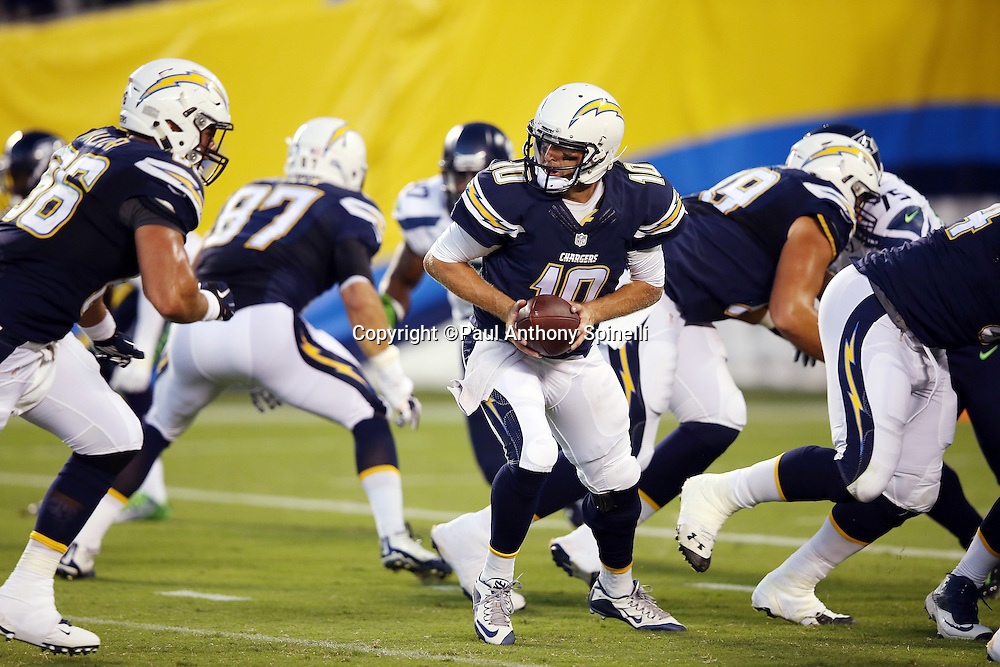 San Diego Chargers quarterback Kellen Clemens (10) looks to hand off the ball on a running play during the 2015 NFL preseason football game against the Seattle Seahawks on Saturday, Aug. 29, 2015 in San Diego. The Seahawks won the game 16-15. (©Paul Anthony Spinelli)