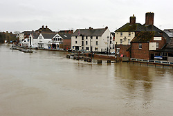 © Licensed to London News Pictures. 17/02/2014; Upton on Severn, Worcestershire, UK.  The river Severn is high at Upton on Severn, but the flood defences have kept the town from flooding.  The army are helping to check the flood defences and transport people to nearby villages cut off by floods.<br /> Photo credit: Simon Chapman/LNP