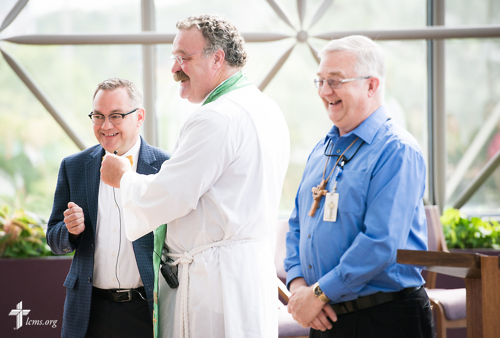 Ross Stroh, executive director of LCMS Accounting and Financial Services (left), acknowledges his mother after being introduced by Chief Financial Officer Jerry Wulf (right) and the Rev. Dr. Matthew C. Harrison, president of The Lutheran Church–Missouri Synod, during a Service of Installation in the International Center chapel of The Lutheran Church–Missouri Synod on Wednesday, Sept. 3, 2014, in Kirkwood, Mo. LCMS Communications/Erik M. Lunsford