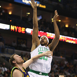 Feb 10, 2010; New Orleans, LA, USA; Boston Celtics center Rasheed Wallace (30) shoots over New Orleans Hornets forward Darius Songaila (9) during the first half at the New Orleans Arena. Mandatory Credit: Derick E. Hingle-US PRESSWIRE