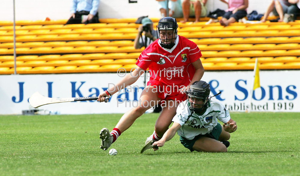 20/8/2005.Pictured in action at the Cork V Limerick camogie semi-final at Nowlan Park in Kilkenny was Cork's Gemma O Connor and Limericks Vera Sheehan..Picture Dylan Vaughan.