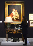 "© Licensed to London News Pictures. 18/03/2013. London, UK A girl looks at ""Good Friends 1889"" by Charles Burnton Barber with an estimated value of 80,000-120,000GBP. Press call for The Collection of Mark Birley at Sotheby's auction house today 18th March 2013. Mark Birley was the owners of members only clubs Annabel's, Mark's Club, George's Bar, Harry's Bar and The Bath and Racquets Club in London. Photo credit : Stephen Simpson/LNP"