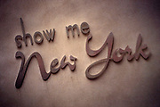 """Manhattan, NY, USA, February 28th 1998: Letters on a wall in Midtown that says """"Show me New York""""."""