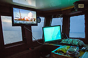 "A trawler boat explodes after picking up a World War Two mine on a television mounted above marine navigation equipment,  installed in the cabin of a fishing boat. Hythe Bay, the English Channel, UK. Luke skippers his boat alone, to keep him company during the trip he has installed a TV. The journey begins with the opening scene of a Bond film where a Trawler boat nets a mine. ""I've caught a few of those in my time"" say Luke as he navigates around mines, shipwrecks and WWII planes.  Luke is a Folkestone based fisherman out trawling for a 12 hour night shift on a fishing trip in his boat Valentine (FE20), Hythe Bay, the English Channel,(photo by Andrew Aitchison / In pictures via Getty Images)"