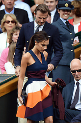 Image licensed to i-Images Picture Agency. 06/07/2014. London, United Kingdom. David and Victoria Beckham arriving in the Royal Box  at the Wimbledon Men's Final.  Picture by Andrew Parsons / i-Images