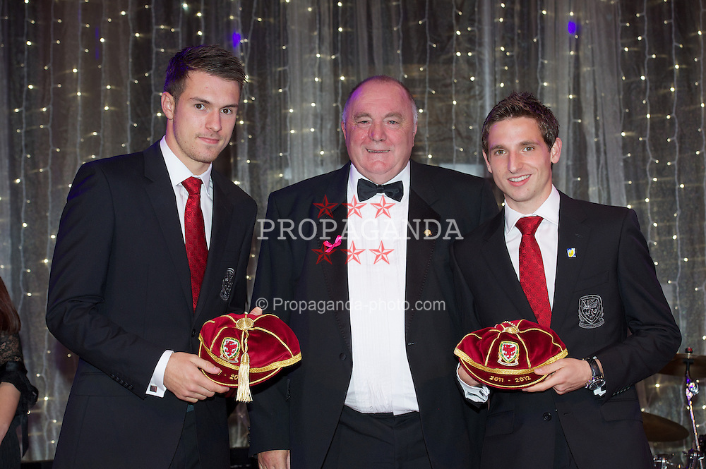 CARDIFF, WALES - Monday, October 8, 2012: Wales' FAW President Trevor Lloyd-Hughes presents caps to Aaron Ramsey [l] and Joe Allen [r] during the FAW Player of the Year Awards Dinner at the National Museum Cardiff. (Pic by David Rawcliffe/Propaganda)