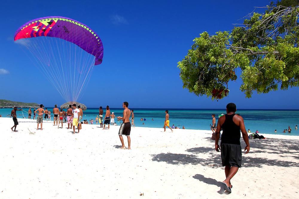 Flying a kite at Guadalavaca, Holguin, Cuba.