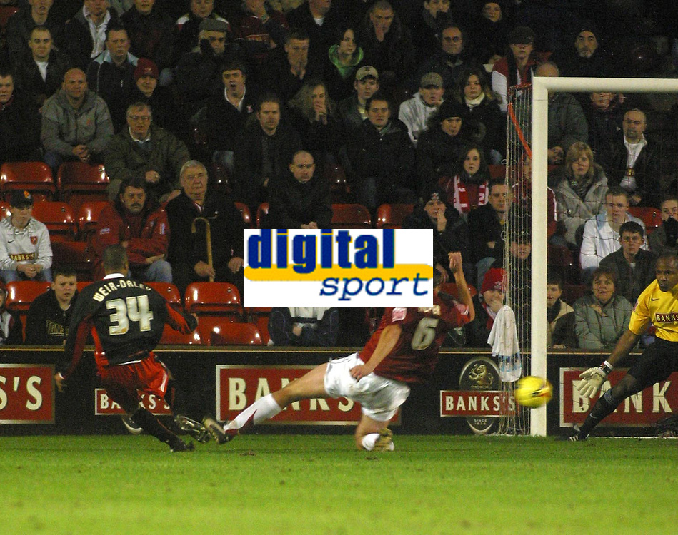 Photo: Dave Linney.<br />Walsall v Lincoln City. Coca Cola League 2. 16/02/2007.<br />Lincoln's Spencer Weir-Daley slots home the first goal to make it 1-0
