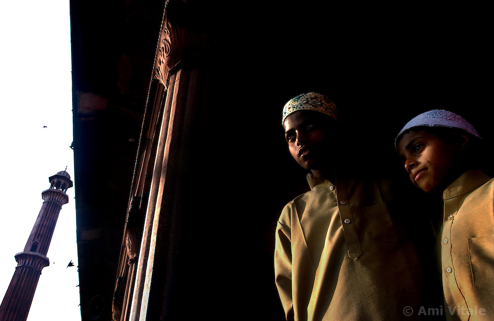 Muslim boys stand inside the Jamia Masjid, or Grand Mosque, the first day of the Muslim Eid al-Fitr holiday marking the end of the holy month of Ramadan in Delhi, India December 17, 2001.  (Getty Images/ Ami Vitale)