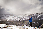 A snowshoer takes in the view of Crystal Crag in the Eastern Sierra Mountains of California.